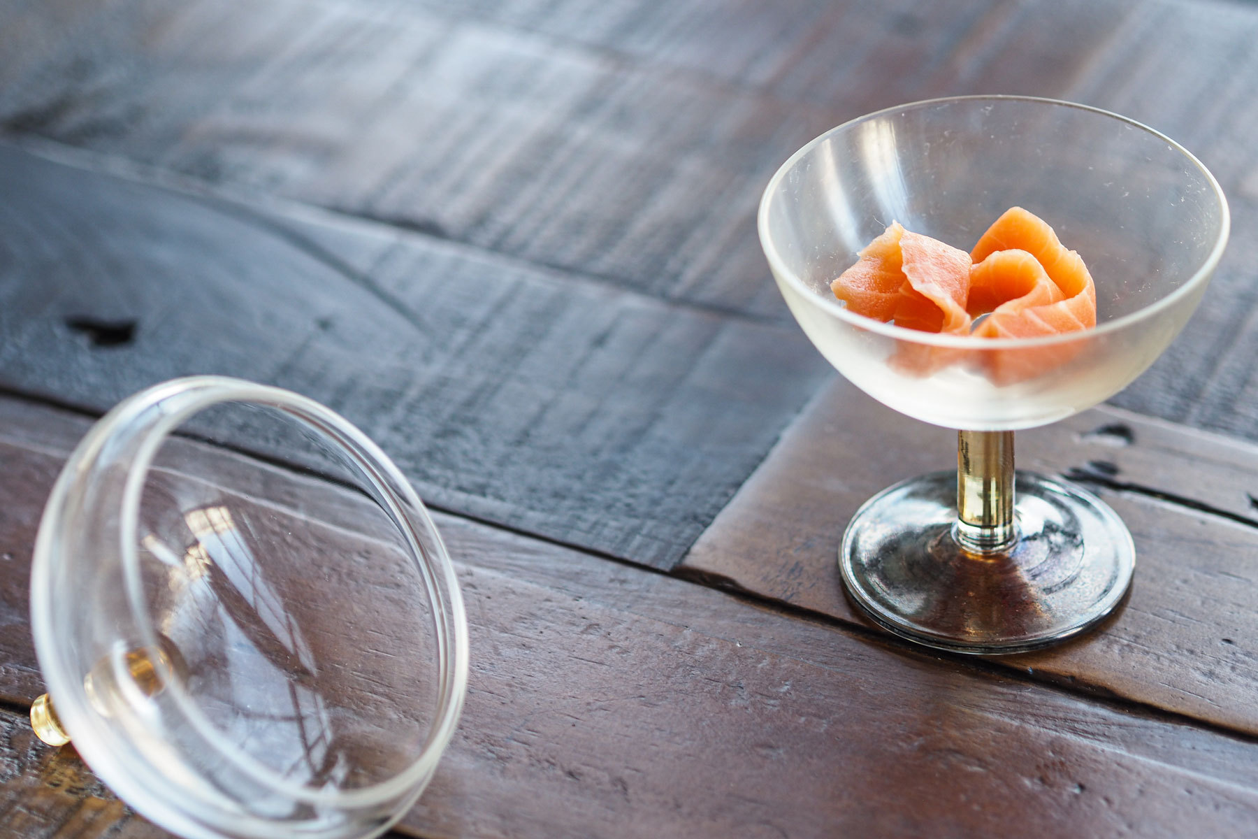 Salmon pieces in an ornate glass smoking cup
