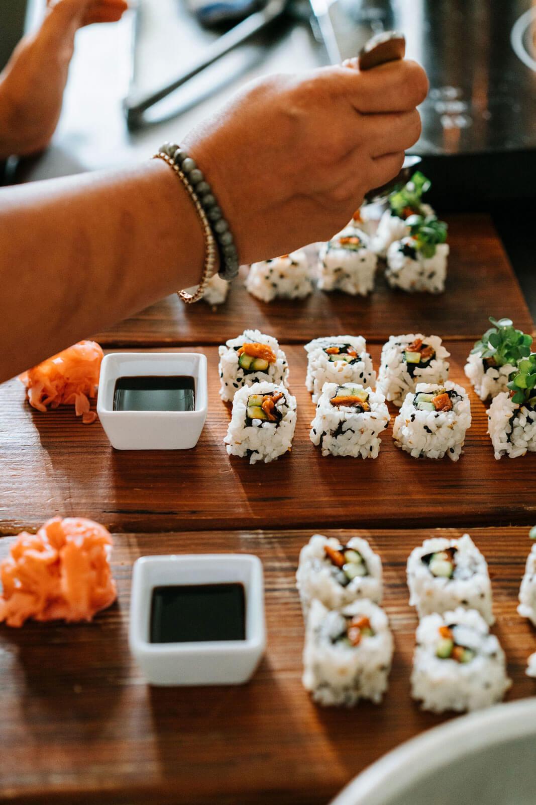 Salmon sushi rolls on wood boards